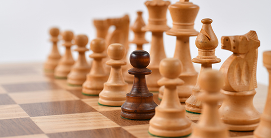 One chess pawn on a board looks different from the rest